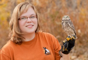 Lisa Tretiak with a burrowning owl